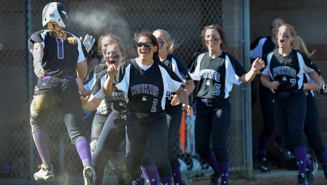 Albany High School players celebrate a run scored by Madison Schmitz (1) in the second inning of their South Sub-Section 6-2A final against Sauk Centre on Thursday at River's Edge Park in Waite Park. Albany went on to win 11-1.