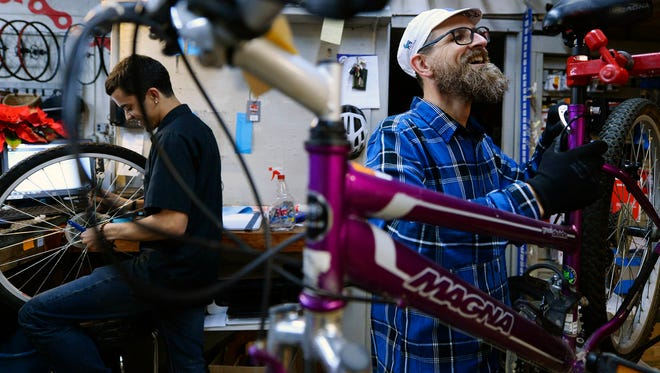 Derrick Rorrer, left, and Clark Evanitus will be among the employees helping to fix up donated bikes at Gung Ho Bikes. The bikes will go to organizations like Big Brothers Big Sisters of York and Adams County, the YMCA of York County and Toys for Tots.