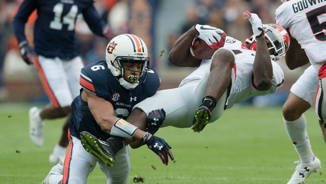 Auburn defensive back Carlton Davis (6) tackles Georgia tailback Sony Michel (1) during the NCAA football game between Auburn and Georgia on Saturday, Nov. 11, 2017, in Auburn, Ala. 