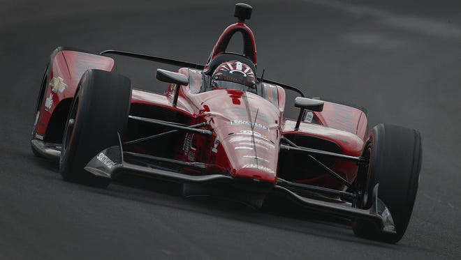 Foyt with Byrd Racing IndyCar driver James Davison (33) rounds turn three on qualification day for the Indianapolis 500 at the Indianapolis Motor Speedway on Saturday, May 19, 2018.