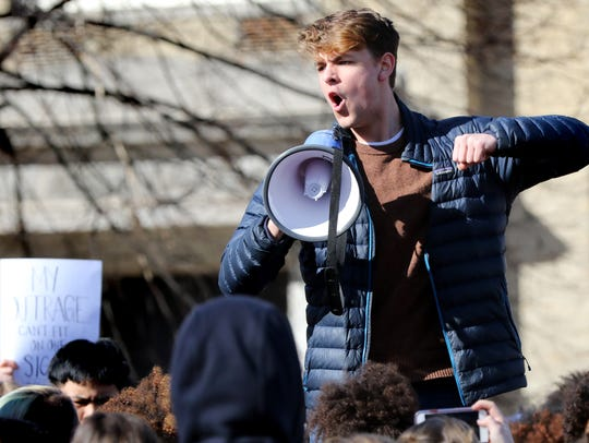 Cal Curran leads a chant during Shorewood High School