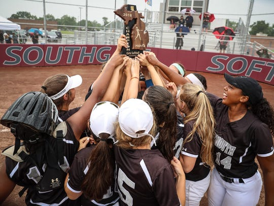 Plymouth players hoist the Division 1 softball regional