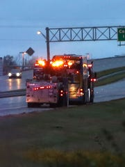 A double-decker bus is towed north on I-65 in Greenwood,