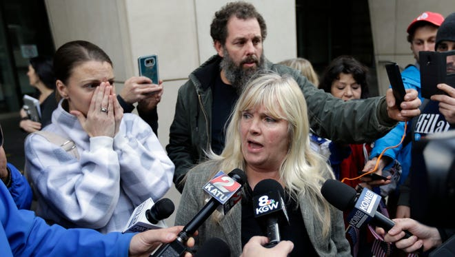 Defendant Shawna Cox speaks outside federal court in Portland, Ore., Thursday, Oct. 27, 2016. A jury exonerated brothers Ammon and Ryan Bundy and five others of conspiring to impede federal workers from their jobs at the Malheur National Wildlife Refuge.