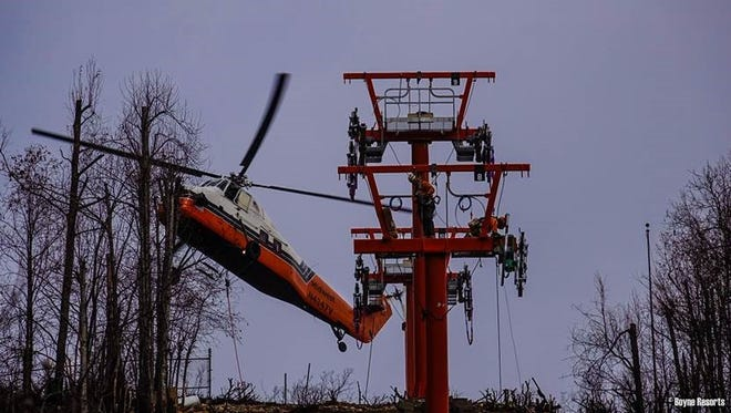 A helicopter lifts parts for rebuilding the Gatlinburg Sky Lift on Tuesday.