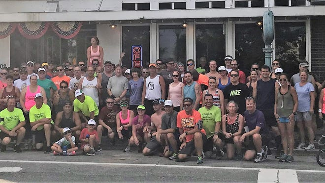 More than 100 runners and walkers gathered at Hell 'n Blazes Brewing Company in Melbourne for last week's Summer Breweries & Fun Run tour.