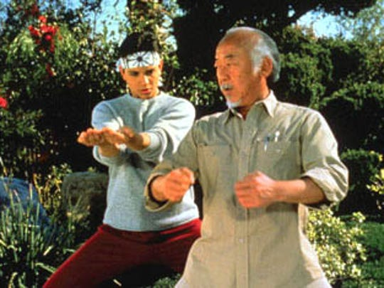 "Pat Morita (right) puts Ralph Macchio through his paces in ""The Karate Kid."""