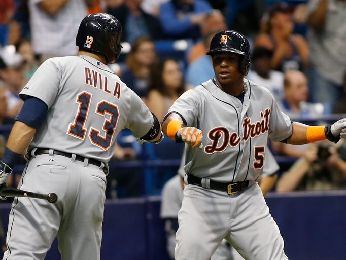 Tigers outfielder  Yoenis Cespedes, right,  celebrates