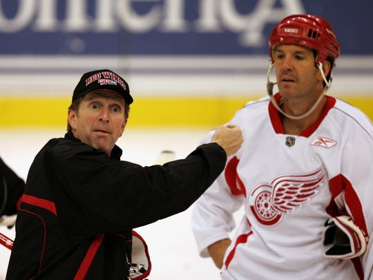 Red Wings coach Mike Babcock gives instructions  as Brendan Shanahan listens on Sept. 27, 2005.