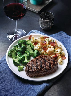 You can order Applebee's sirloin steak with two sides.