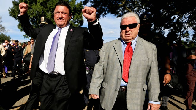 Oct 1, 2016; Baton Rouge, LA, USA; LSU Tigers interim head coach Ed Orgeron with defensive line coach Pete Jenkins walk down Victory Hill with the team before a game against the Missouri Tigers at the Tiger Stadium. Mandatory Credit: Derick E. Hingle-USA TODAY Sports