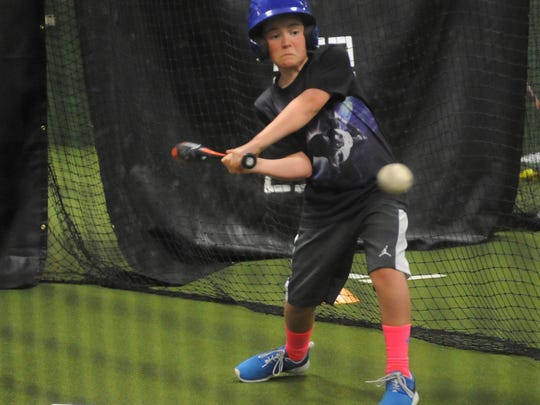 A Mountain Home youth baseball player swings at a pitch in one of the batting cages at the Auto Services Inc. and Finley Family Sports Complex.