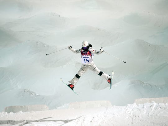 Japan's Junko Hoshino jumps during a moguls training session at the Rosa Khutor Extreme Park, prior to the 2014 Winter Olympics, Feb. 4, 2014, in Krasnaya Polyana, Russia.