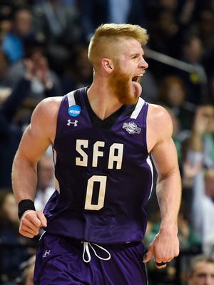 Stephen F. Austin Lumberjacks forward Thomas Walkup (0) reacts in the second half in the first round of the 2016 NCAA Tournament against the West Virginia Mountaineers at Barclays Center.