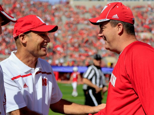 Nebraska head coach Mike Riley, left, and Wisconsin head coach Paul Chryst meet before an NCAA college football game in Lincoln, Neb., Saturday, Oct. 10, 2015. (AP Photo/Nati Harnik)