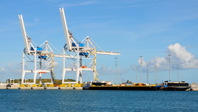 A ship is docked near the twin cargo cranes at Port Canaveral on Tuesday.