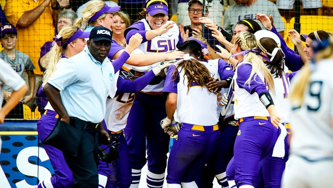 LSU softball player mob Bailey Landry after her two-run home run helped the Tigers to an 8-0 win over Arizona in the NCAA Super Regionals.