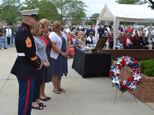 The family of the late Ed Hearthway, a Vietnam War veteran, prepare to present the wreath during a Memorial Day ceremony at the War Veterans Memorial at the Wicomico Youth & Civic Center on Monday, May 29.