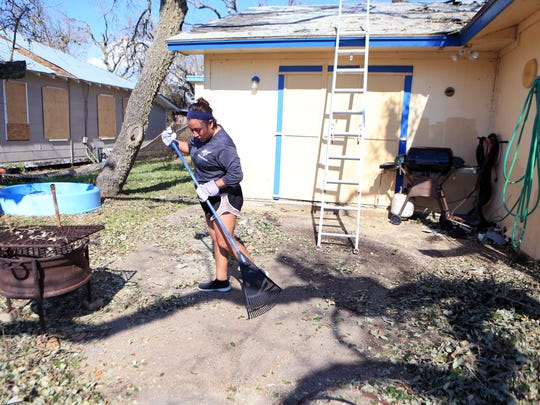 Rockport-Fulton High School graduate Dulce Trujillo cleans up a home in Rockport on Aug. 30, 2017. Students helped clean up homes that sustained damage from Hurricane Harvey after unloading donations.