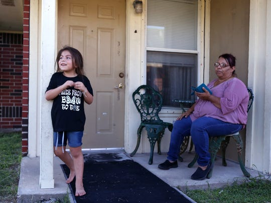 Addison Martinez (left), 5, plays outside Ellie Morin's apartment at Rincon Point Apartments in Taft on Thursday, October 12, 2017. Residents are banding together to fight the evictions that the management company are stating are due to damage from Hurricane Harvey.