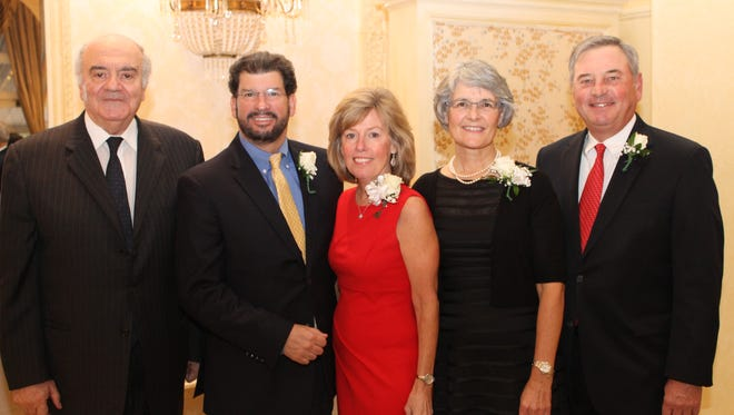 The cocktail reception's honorees were, from left, Paul T. Khoury, MD; Peter and Karen Herrero; and Jennifer and Ralph Watts.