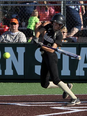 Lauren Roberts/Times Record News Archer City's Maeley Herring gets a base hit in Game 1 of the Region I-2A quarterfinals against Petrolia Thursday, May 12, 2016, at Mustangs Park.