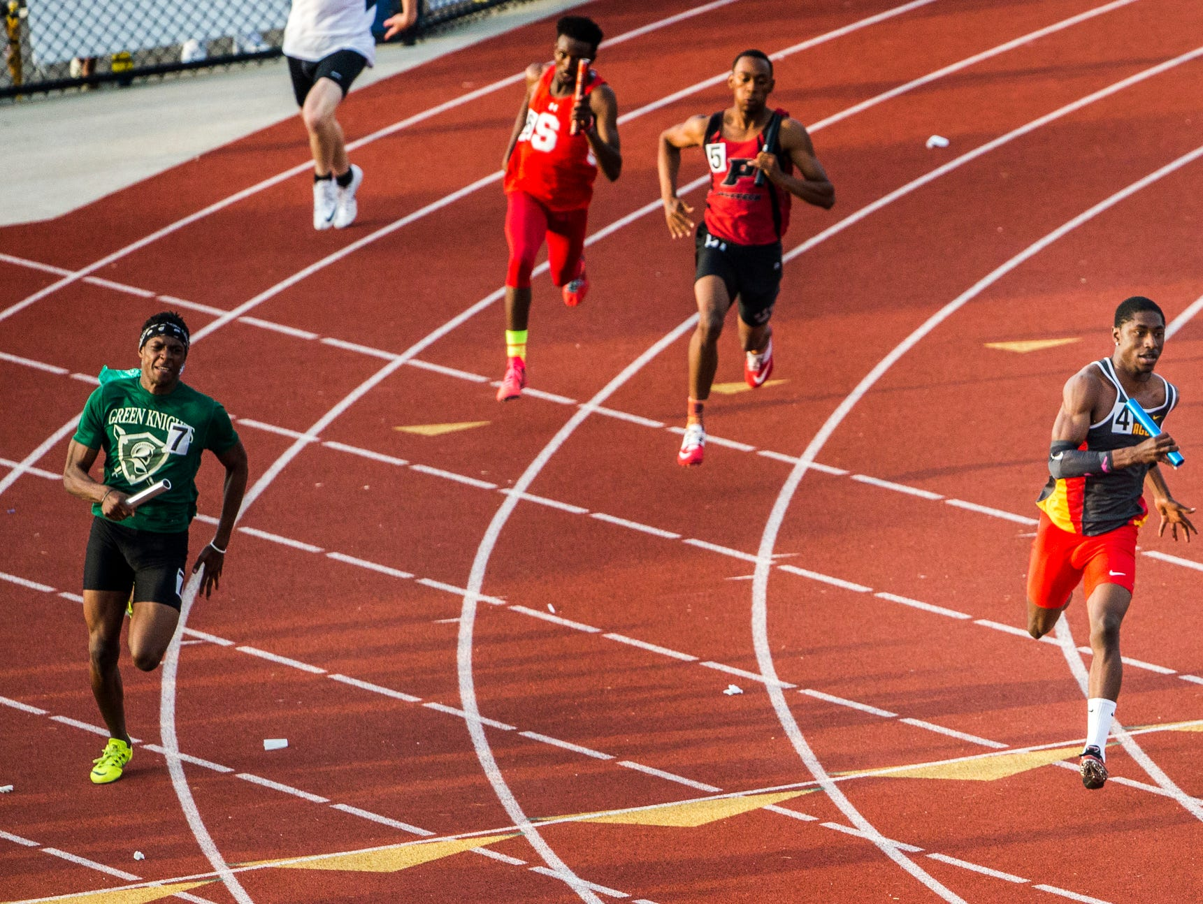 Glasgow's Ja'saan Cunningham (No. 4) anchors his team to a win in the Boys 4x200 Meter Relay event at the Meet of Champions at Dover High School on Wednesday evening.