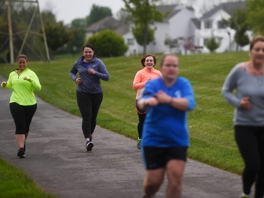 Lisa Little runs a 5K with friends and family at Cousler Park. Little wanted to participate in one last 5K with her kidney, nicknamed Mabel, before donating her to a woman with stage five chronic kidney disease.
