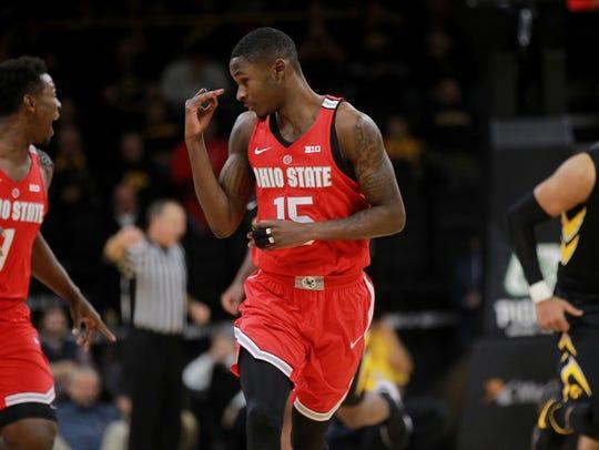 Ohio State's Kam Williams celebrates a basket during
