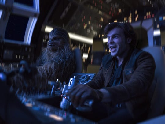 "Chewbacca (Joonas Suotamo, left) and Han Solo (Alden Ehrenreich) take flight in the Millennium Falcon in ""Solo: A Star Wars Story."""