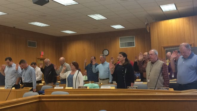 Portage County Board members take an oath of office Tuesday in County Board Chambers.