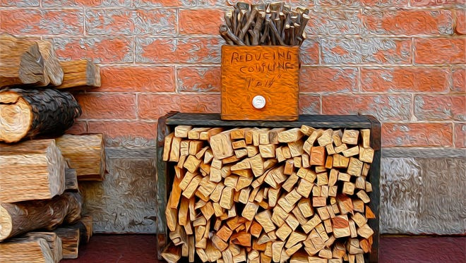 At first this picture of firewood, on my porch in Corn Hill, may appear two-dimensional, but it's not.