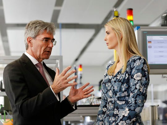 Ivanka Trump, daughter and adviser of U.S. President Donald Trump, talks to Joe Kaeser , chairman of Siemes when visiting the Siemens Technik Akademie after she participated in the W20 Summit in Berlin Tuesday, April 25, 2017.