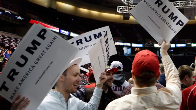 Supporters of Republican presidential candidate Donald Trump hold signs before a rally at the Times Union Center on Monday, April 11, 2016, in Albany, N.Y. (AP Photo/Mike Groll)