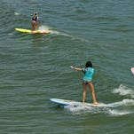 Amateur women's longboard heat on Sunday at the 30th Annual National Kidney Foundation Rich Salick Pro/Am Surf Festival at the Westgate Resorts Cocoa Beach Pier.