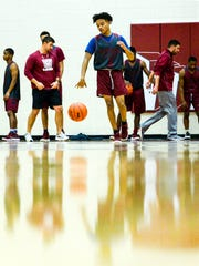 Westside High School guard Odarius Cade dribbles near teammates during practice at the school in Anderson on Monday.