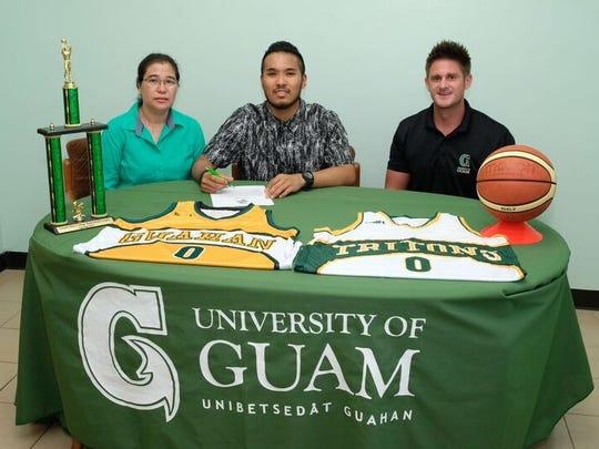 Giorgio Meneses, center, UOG Head Coach Brent Tipton,