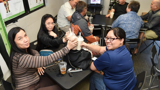 From left, Irene Cabral, CarriAnn Cabral, and Kimberly Gogue enjoy a healthy meal-replacement shake breakfast at Health Craze in Tamuning on Feb. 18.