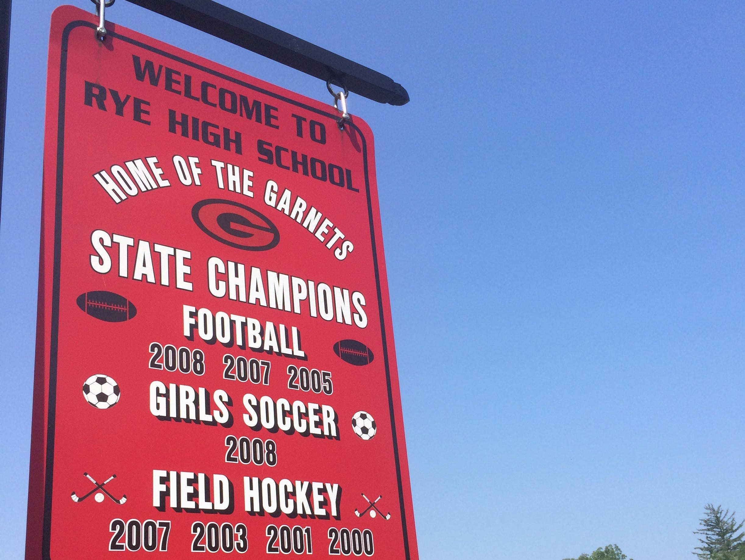 The Rye football team (background) holds its first football practice of the season at Rye High School's Nugent Stadium.