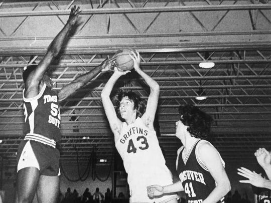 Monsignor Donovan's Jim Dolan shoots over a Toms River South defender during a 1980 game.