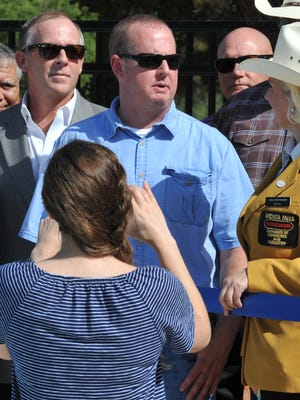Camp Fire of North Texas Board President, Brent Davenport talks with Wichita Falls Chamber of Commerce and Industry Gold Coat, Lisa Pettijohn before cutting the ribbon celebrating the grand opening of the Camp Fire of North Texas new swimming pool located in Harrell Park.