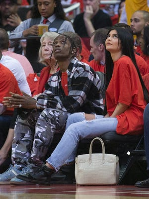 Houston rapper Travis Scott and Kylie Jenner watch courtside during Game Five of the Western Conference first round of the 2017 NBA Playoffs at Toyota Center.