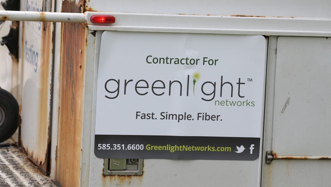 Work crews working for Lantek Fiber Optic Service, a contractor for Greenlight Networks, install a new fiber line that will help to increase customer capacity along Elmwood Avenue in Brighton Thursday, April 26, 2018.