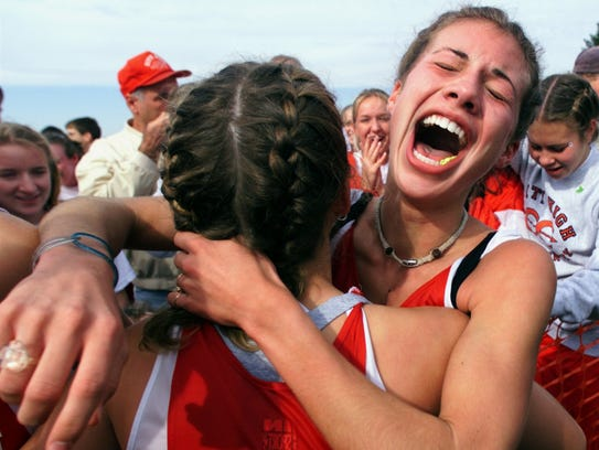 Iowa City High's Michelle Lilienthal celebrates winning