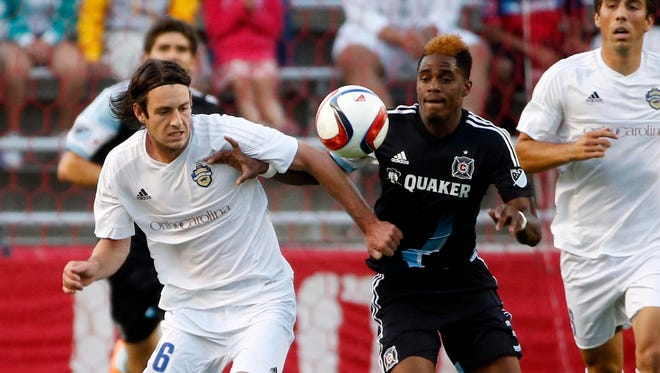 Jun 30, 2015; Bridgeview, IL, USA; Charlotte Independence midfielder Paolo Delpiccolo (36) battles for the ball against Chicago Fire defender/midfielder Joevin Jones (3) during the first half of the U.S. Open Cup soccer game at Toyota Park. Mandatory Credit: Kamil Krzaczynski-USA TODAY Sports