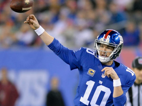 FILE - In this Nov. 14, 2016, file photo, New York Giants quarterback Eli Manning (10) throws against the Cincinnati Bengals during the first quarter of an NFL football game, East Rutherford, N.J. Ben Roethlisberger and Eli Manning are inextricably linked. Taken 11 picks apart in the 2004 NFL Draft, the two quarterbacks have spent the last dozen years watching each other from afar, using the other's success as a measuring stick of their own accomplishments. The Giants visit the Pittsburgh Steelers on Sunday. (AP Photo/Bill Kostroun, File)