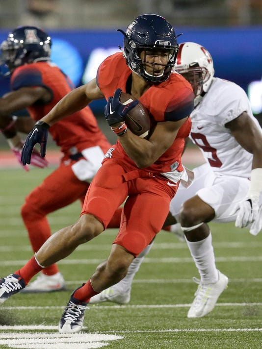 FILE - In this Oct. 29, 2016, file photo, Arizona wide receiver Trey Griffey runs away from Stanford safety Ben Edwards (9) during the second half of an NCAA college football game in Tucson, Ariz. Trey Griffey and Jerome Lane are spending mother's day weekend talking all about their fathers. Griffey's dad is baseball Hall-of-Famer Ken Griffey Jr., Jerome Lane's dad is Jerome Lane an ex-NBA player.   (AP Photo/Rick Scuteri)
