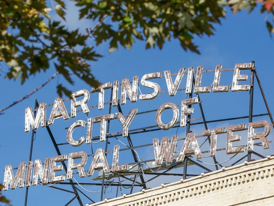 An old Martinsville City of Mineral Water sign sits