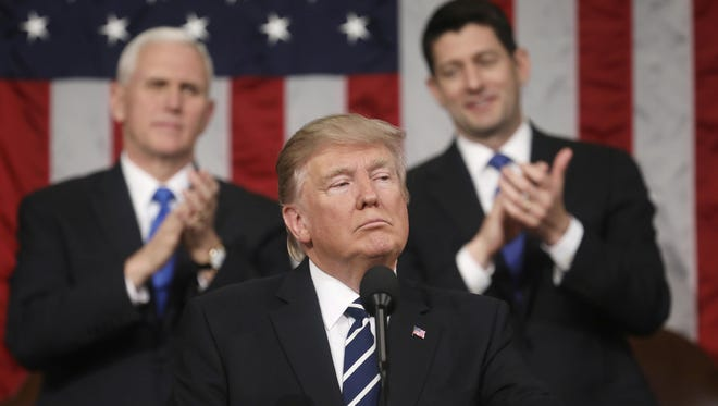 President Donald Trump addresses a joint session of Congress on Tuesday as Vice President Mike Pence and House Speaker Paul Ryan of Wisconsin listen.