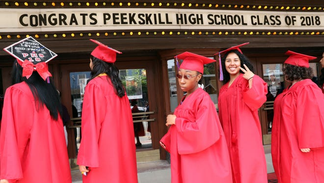 Graduates follow the procession for the Peekskill High School commencement at Paramount Hudson Valley June 24, 2018.